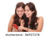 two girls smiling and seeing in cell phone  , white background. photography - stock photo