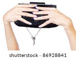 isolated body part shot of beautiful young woman's manicured hands with fancy clutch on white - stock photo