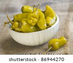 Marinated pepper in bowl with garlic, soft focus - stock photo