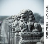 ancient vivid stone lion on the bridge in beijing,China - stock photo