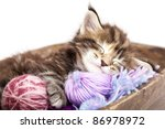 Stock photo kitten sleeping resting in a basket of balls of yarn 86978972