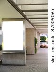 Blank billboard in a shopping mall passage - clipping path included - stock photo