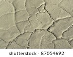abstract detail of fissured light brown mud - stock photo