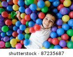 Kid, play, ball - little boy playing with balls - stock photo