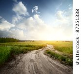 Rural Road Through Fields With...
