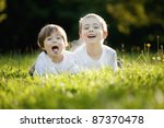 a young boy and girl laying in... | Shutterstock . vector #87370478