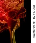 abstract picture showing some colorful red smoke in dark back - stock photo