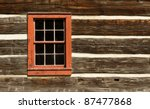 A Red Window On The Wall Of A...