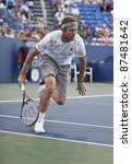NEW YORK - SEPTEMBER 01: Mardy Fish of USA returns ball during 2nd round match against Malek Jaziri of Tunisia at USTA Billie Jean King National Tennis Center on September 01, 2011 in NYC - stock photo
