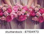 Stock photo trio of pink bridesmaid posies 87504973