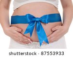 Pregnant Belly With Blue Ribbo...