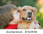 Stock photo boy kissing dog 8764948