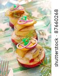 herring appetizer towers  with slices of potato and apple  gherkin,red onion and dill for christmas - stock photo