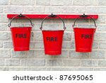 Three Fire Buckets Hanging On ...