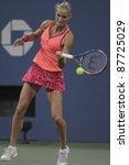 NEW YORK - SEPTEMBER 01: Arantxa Rus of the Netherlands returns ball during 2nd round match against Caroline Wozniacki of Denmark at USTA Billie Jean King National Tennis Center on Sept 01, 2011 in New York City, NY. - stock photo