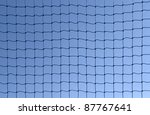 full frame background showing a dark netting in front of blue sky - stock photo