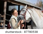 blonde woman and white horse | Shutterstock . vector #87780538