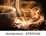 Strange golden smoke taking away from coffee seeds - stock photo
