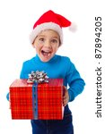 Laughing little boy in Santa's hat with red gift box, isolated on white - stock photo