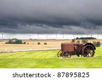 Old Rusty Tractor With Storm...