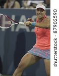 NEW YORK - AUGUST 31: Angelique Kerber of Germany returns ball during 2nd round match against Agnieszka Radwanska of Poland at USTA Billie Jean King National Tennis Center on August 31, 2011 in NYC - stock photo