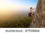 young man climbs on a rocky... | Shutterstock . vector #87938866
