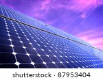 Solar Panels Against The Sky By Sunset - stock photo