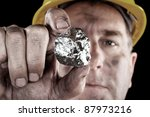 a silver miner shows off his... | Shutterstock . vector #87973216