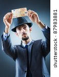 detective looking at fake money | Shutterstock . vector #87983881