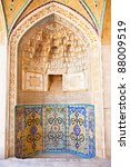 Small photo of Tiled and brick background, oriental ornaments from Agha Bozorg school and mosque in Kashan, Iran
