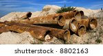 Abandoned rusty pipes from an old pipeline.Panoramic picture, not a crop - stock photo
