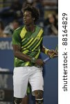 NEW YORK - AUGUST 29: Gael Monfils of France returns ball during 1st round match against Grigor Dimitrov of Bulgaria at USTA Billie Jean King National Tennis Center on August 29, 2011 in NYC - stock photo