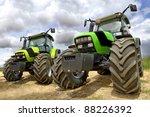 Постер, плакат: Green tractors in the