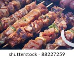 Cooking kebab and sausage on a barbecue grill - stock photo