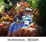 A Pair Of Colorful Scarecrows