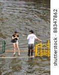 BANGKOK, THAILAND - NOVEMBER 05 : Heavy flooding from monsoon rain in Ayutthaya and north Thailand arriving in Bangkok on November 05,2011 Bangkok, Thailand,At Paholyothin & Ladprao Rd. - stock photo