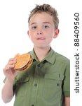 Little Boy Eating A Hamburger....