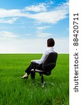 businesswoman sitting on chair and looking in expanse - stock photo
