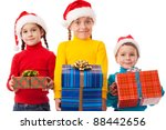 Three smiling kids in Santa hats with gift boxes, isolated on white - stock photo