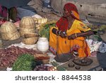 Woman Selling Fruit And...