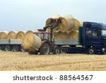 Tractor Loading Hay On The...