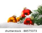 Decorative Christmas balls and Christmas tree on the snow. - stock photo
