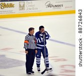 TORONTO, CANADA – NOV 13: Referee Kerry Fraser talks to Hall of Famer Doug Gilmour before interview during Hockey Hall of Fame Legends Classic game on Nov 13, 2011 in Toronto, Canada. - stock photo