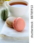 traditional french macrons with tea set on the background - stock photo