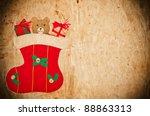 Vintage Christmas postcard with Christmas sock and teddy bear - stock photo