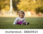 Little Girl Playing In Grass ...