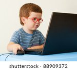 child with glasses using... | Shutterstock . vector #88909372