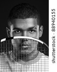 Monochrome portrait of young african tennis player - stock photo