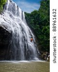 abseiling down the waterfall... | Shutterstock . vector #88961632
