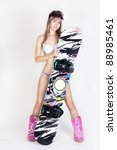 young snowboarder girl in bikini  with snowboard - stock photo